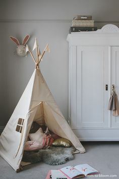 A teepee is perfect for creating a cosy play corner