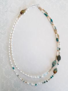 Double strand necklace made from fresh water pearl, turquoise, assorted gemstones and crystal.  Private commission, created by Not Just Red Ones.