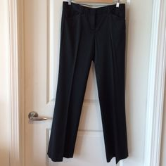 Sleek Theory Trousers Sleek black cotton and wool blend Theory trousers with a micro rib detail. These trousers almost have a silky feel to them. They look and feel fabulous. Fantastic condition. Theory Pants Trousers