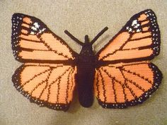 This is a cute monarch butterfly toy. It has a wingspan of 42 cm and is 21 cm long :)