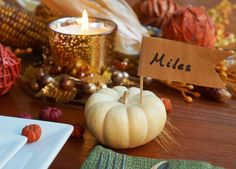 Thanksgiving Place card DIY - all you need is a paper bag, scissors, a toothpick, and a mini pumpkin!