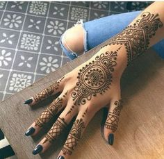 A henna tattoo is a temporary tattoo made with henna. Henna is an Arabic word, referring to a paste that consists of crushed branches, leaves of a Henna plant. Henna Hand Designs, Mehndi Designs Finger, Pretty Henna Designs, Henna Tattoo Designs Simple, Mehndi Designs Book, Mehndi Designs For Beginners, Mehndi Designs For Girls, Unique Mehndi Designs, Design Tattoos