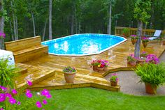 above ground pool deck. I like everything about this deck except the built on bench. I'd replace it with railing.