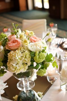 Gorgeous centerpieces in peach, yellow & chartreuse.