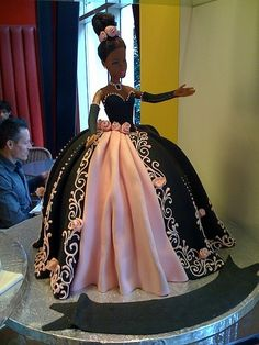 This page is all Barbie cakes. I love the black and pink with the detail on the edges. It would be beautiful on a different style of cake.