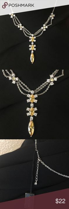 Fifth Avenue Liquid Honey Rhinestone necklace NWT Gorgeous clear and yellow rhinestones on a silver scalloped chain. 💗💗💗💗 Fifth Avenue Jewelry Necklaces