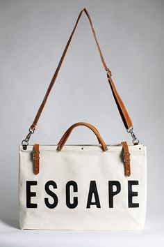 The Forestbound ESCAPE Canvas Utility Bag features sturdy black leather handles and buckle straps with metal hardware. Canvas Weekender Bag, Canvas Tote Bags, Painted Canvas Bags, Christmas Bags, New Bag, Handmade Bags, Handmade Leather, Leather Handle, Shoulder Bag