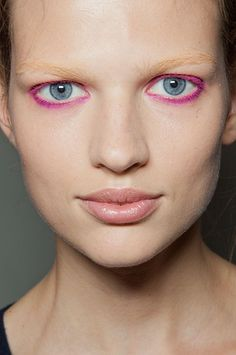 Keeping with the 2013 trend of colored lashes try MAC Cosmetics eyeliner in Magenta. See Mac at The Makeup Show NYC in May