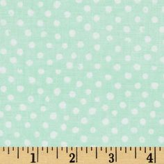From Dear Stella Designs, this polka dot cotton fabric is perfect for quilting, apparel and home decor accents. Colors include white polka dots on a mint green background.