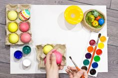 woman painting easter eggs happy easter