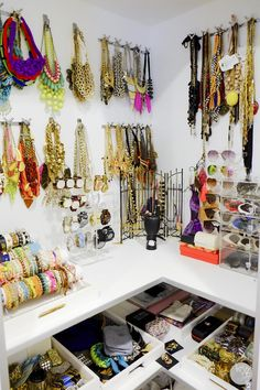 An organized accessory corner makes everything completely accessible and pretty too...I especially love the necklace hooks and the sunglasses display and drawers