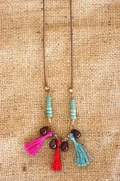 A party of colored tassels & turquoise beads teamed up together on a leather cord. The perfect pop of color!
