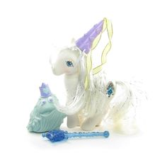 This vintage G1 My Little Pony is Princess Tiffany, she's a Princess Pony from Year 5. Princess Tiffany (called Princess Pearl in the UK) is a white pegasus and has white hair with bits of silver tins