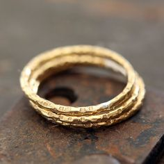 14k yellow gold textured rings. A set of 3 14 karat gold rings that I have hammered a unique texture onto. This listing is for a set of 3 rings. A single ring is available here in this listing. The ri