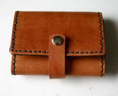 Leather tri-fold wallet with snap strap for him or her! $79 handmade. http://justjaynes.com/leatheraccessories/leather-tri-fold-wallet-with-snap-strap