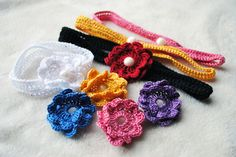 The flowers attach to the headband with the button, so that you can mix and match the colors to coordinate with each of baby's outfits.