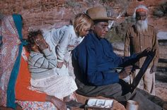 Albert Namatjira painting with his family.    aliceonline.com.au