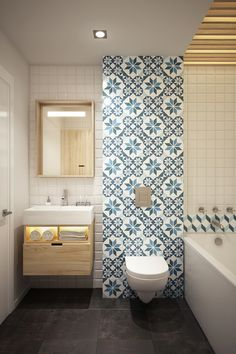 The patterned feature wall really helps to bring this small bathroom to life.