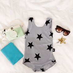 Love this sunny style - swooning over the starry swimsuit! #kidsfashion (click to IG to see details on where to Buy!)