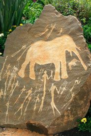 Prehistoric rock carving - woolly mammoth and ancient hunters - Man-made global warming started with ancient hunters - agu.org
