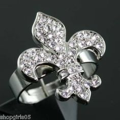 NEW! FLEUR DE LIS ADJUSTABLE SILVER RHINESTONE RING. THIS RING IS REALLY CUTE AND LOOKS GREAT ON.