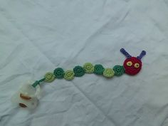 This nice pacifier clip is very easy to crochet.
