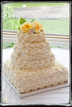 The best wedding cake frosting for icing a wedding cake. The classic Italian meringue wedding cake icing recipe is smooth creamy and not too sweet.