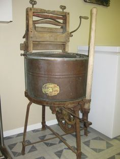 This picture depicts the 1926 Antique Cast Iron/Wood, Hand Pump Wringer washer. Now a necessity in every home, the washer started in humble beginnings in but quickly became an average household item during the