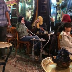 """Girls smoking shisha and drinking tea at El Fishawy, the oldest ahwa in Cairo.  Photo by Tinne Van Loon @tinnevl  #elfishawy #khanelkhalili #islamiccairo…"""
