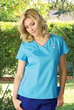 Beautiful in blue. We love this gorgeous koi Ashley Top in Turquoise. Perfect scrub top for nurses, dentists or vets. £24.99   #medicalscrubs #nursescrubs #dentistscrubs #nurses #dentists #bluescrubs #nurseuniform