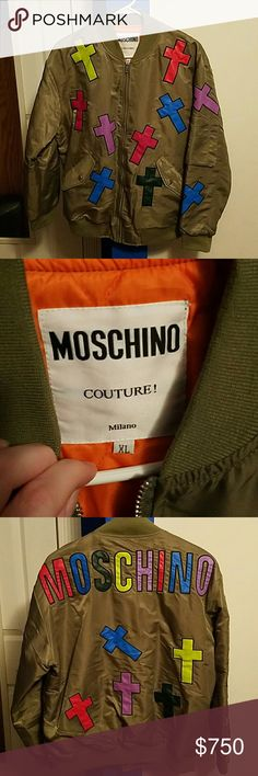 """AUTHENTIC MOSCHINO BOMBER JACKET NWOT. Only tried on once. Size XL. Army green bomber with multicolor crosses all over. Orange quilted interior. Three exterior pockets, one pocket is on the left hand sleeve. One interior pocket on the left side. It says """"MOSCHINO"""" on the back with colorful letters. Very beautiful and rare jacket. Sold out everywhere. MINT CONDITION.   RETAIL PRICE: $1,300 Moschino Jackets & Coats"""