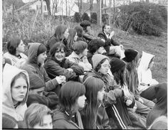 The 1975 Track team on the hill at Killingly High School watching the concluding events. Kathy Spring, Diane Howie, Assistant Coach Mrs. Judy Standish, Robin Rogalski, Peggy Evans, Heather Harwood, Pat Bressler, Jackie Hall, Tammy Gladue