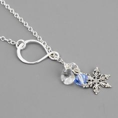 Silver Snowflake Necklace - Swarovski Crystal and Sterling Silver Lariat Necklace - Winter Wedding Jewelry by MyDistinctDesigns on Etsy https://www.etsy.com/listing/163329646/silver-snowflake-necklace-swarovski