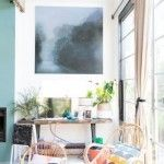 Painting by Adriane Strampp<br /> Chairs -left Ebay - original 1960s Dutch Rattan chair by Rohe and Family Love tree chair, Rachel Castle woollen cushions, vintage lamp (Waverley Antiques)<br /> Rustic TV table designed by Kali Kavanagh Interiors