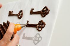 Make chocolate keys (or other designs) by piping melted chocolate onto parchment paper over a template.