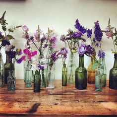 Display wildflower stems in old vintage bottles and jars for a pretty and down-to-earth sideboard.