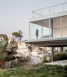 This house outside Barcelona by Spanish studio MDBA features a glazed living room that thrusts out towards the descending landscape #Architecture
