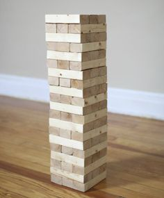 If you're ready to graduate from the tabletop version of Jenga to an oversized version of the game, it's not a difficult project to make with some boards, a saw and sandpaper. To play, wood blocks are stacked in a tower; each player removes a block, stacking it back on top of the tower, hoping he isn't the one who makes it fall.
