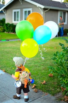 Back view of @Marian Cacciatore's son dressed up as Russell from the movie Up! Photo taken by @Mara Dean.