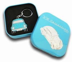 Key Rings with the design of the VW Beetle front, 4 different colors. - Includes a individual tin gift box for each key ring. - Material: chrome-plated metal with soft enamel finish. - Size: 4x10x0.3