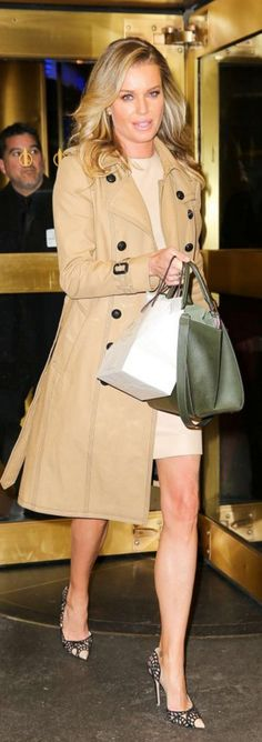 Who made Rebecca Romijn's jewelry and tan trench coat?