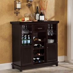 A definite must-have for wine aficionados, this impressive wine bar features 12 wine slots, a drawer, two shelves and cabinets, wine glass holders, removable bamboo cutting board and expandable top.