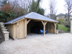 Oak Frame Garage with hand made Ledge and Brace door and oak feather-edge cladding. Landsdowne, Bath, Bath and North East Somerset, South West England, UK. English Oak Buildings.