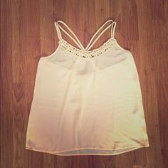 White Top with Floral Neckline White top with floral embellishments on neckline, barely worn in great condition Forever 21 Tops Tank Tops
