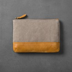Whether you're spending the weekend away or are just organizing your bathroom drawers, do so in style with the Canvas & Leather Cosmetic Bag from Hearth & Hand™ with Magnolia. The cosmetic bag is given a simple design with the canvas body and leather stripe along the bottom and zipper pull. From makeup to travel bottles to toiletries, this cosmetic bag will keep your things orderly no matter if you're staying home or are on the go.<br><br>Celebrate the eve...