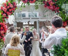 Mr & Mrs signs add sparkle and fun to a floral arch.