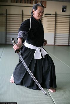 The original classical pronunciation is Chiburui (see note). Nowadays some people especially the younger generation say Chiburi. Both are acceptable in Iaido. However Oe Sensei always used the term Chiburui For this reason I shall use this pronunciation. Chiburui is the action which shakes the blood off the blade before putting it back in the Saya. In Seiza forms Chiburui movements are remarkably large and industrious.