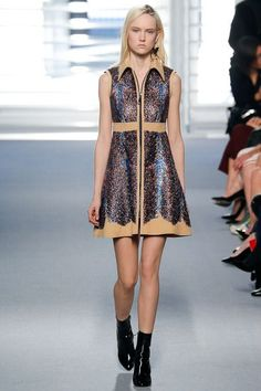 This dress comes from the Louis Vuitton Autumn/Winter 2014-15 Ready-to-wear collection by Nicolas Ghesquiere. This look was inspired by the 1930s due to the front zipper. The zipper became popular during the 1930s and was seen a lot on women's dresses on the front, except it usually went from chest to waist and stopped. This dress also contains a collar and a flare out at the waist like 1930s dresses. 3/15/16