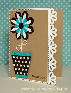 handmade card ... Die Cut Flower using Sizzix and Punches  ... kraft with bright white, black and turquoise ... narrow top side with row of punched flowers in white ... like the graphic strength of the colors ...