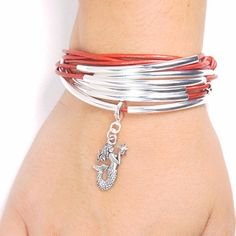 The Mermaid and Starfish charm,in silver tone pewter, can be a great addition to your Lizzy James nautical themed charm collection. An easy to use lobster clas